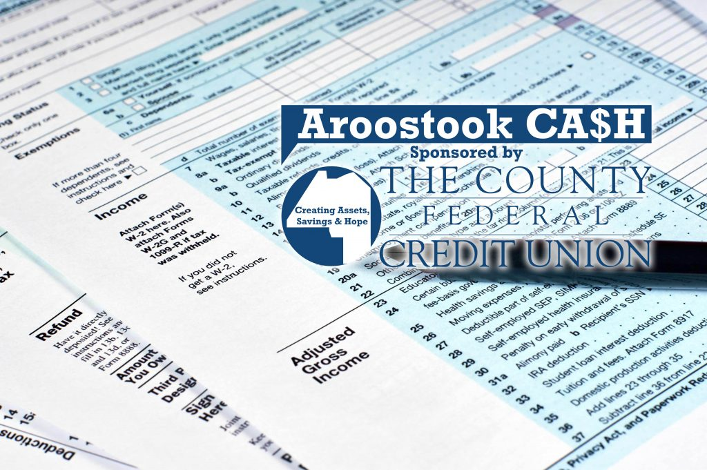 Tax reporting and pen. Filling out tax forms With Cash Coalition and CFCU logos