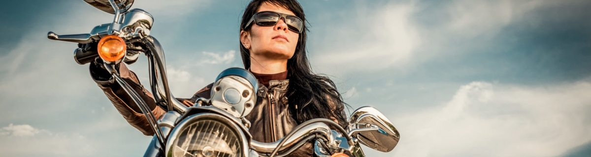 Woman on Motorcycle Looking up in direction she may travel