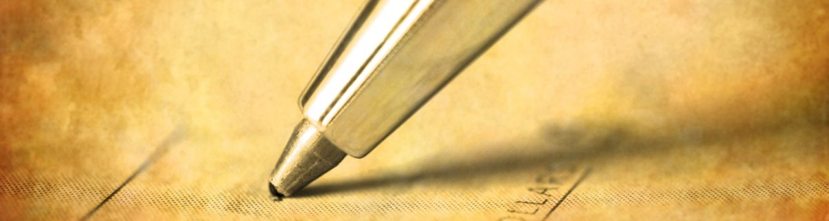 Close up photo of ink pen writing a check