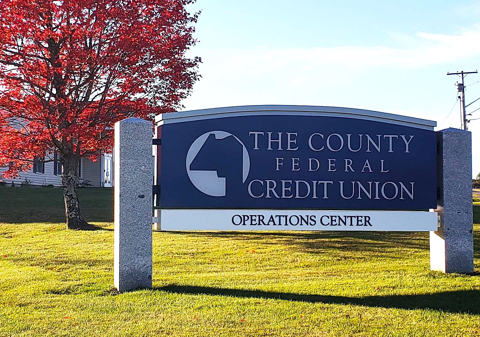 Fall foliage photo of Operations Center Sign