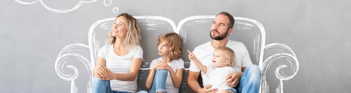 Family Sitting on floor in front of drawing of couch. Thought bubble or new home.