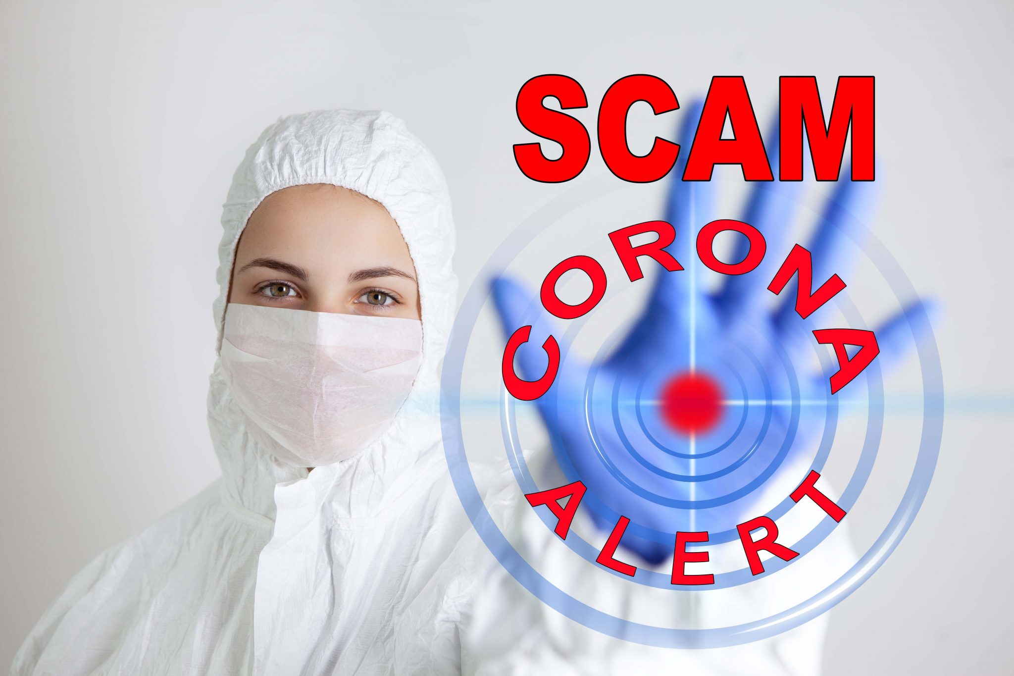 Health care person holding up hand with words Scam corona alert